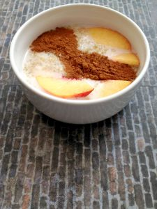 Vegan, Gluten-Free and Sugar-Free Peaches and Cream Quinoa Breakfast Bowl